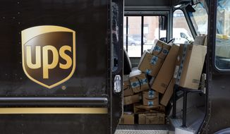 FILE- In this Dec. 19, 2018, file photo packages await delivery inside of a UPS truck in Baltimore. United Parcel Service Inc. reports financial results Thursday, Jan. 31, 2019. (AP Photo/Patrick Semansky, File)