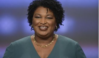 In this May 20, 2018, file photo, then-Georgia Democratic gubernatorial candidate Stacey Abrams participates in a debate in Atlanta. (AP Photo/John Amis, File)