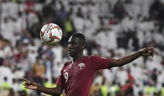 Qatar's forward Almoez Ali eyes with ball during the AFC Asian Cup semifinal soccer match between United Arab Emirates and Qatar at Mohammed Bin Zayed Stadium in Abu Dhabi, United Arab Emirates, Tuesday, Jan. 29, 2019. (AP Photo/Hassan Ammar)