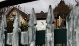 In this photo taken on Tuesday, Jan. 29, 2019, a view of the entrance gate to Rue de Chevreuse, close to the cottage which served as Ayatollah Ruhollah Khomeini's operational and media headquarters during his four month stay in October 1978, in Neauphle-Le-Chateau, west of Paris. Sheltered in a cottage in a sleepy village outside Paris, Ayatollah Ruhollah Khomeini piped out messages daily to hundreds of followers clamoring to glimpse their glowering idol with black turban, and amplified his pronouncements with recorded messages to Iranians at home, turning his humble abode into an international megaphone for the Islamic revolution. (AP Photo/Francois Mori)