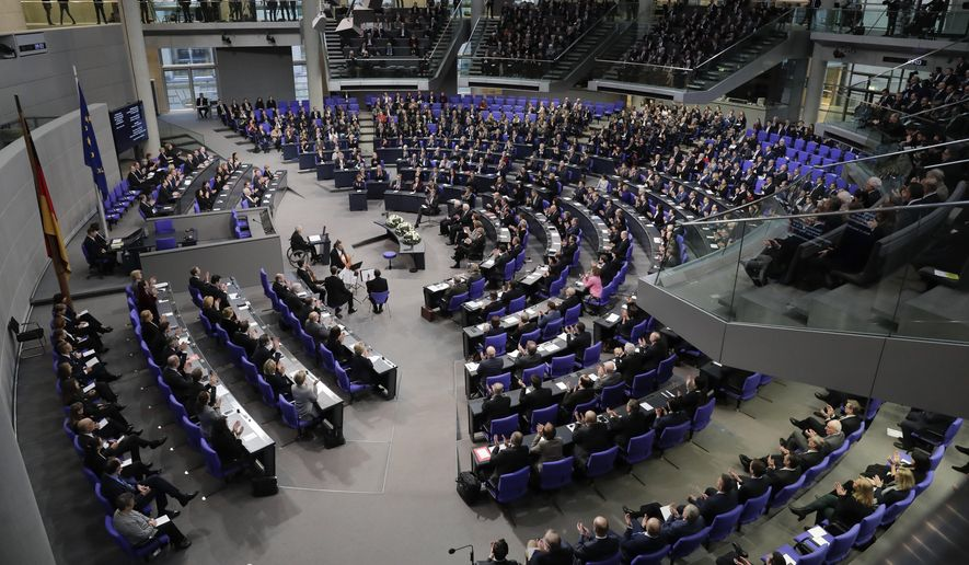 German parliament President Wolfgang Schaeuble, center left at the speakers desk, delivers his opening speech during a remembrance session of the parliament Bundestag to commemorate the victims of the Holocaust at the Reichstag building in Berlin, Thursday, Jan. 31, 2019. (AP Photo/Markus Schreiber) ** FILE **