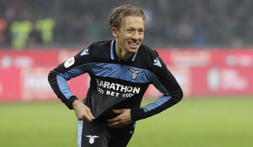 Lazio's Lucas Leiva celebrates after scoring the decisive penalty during an Italian Cup quarterfinal soccer match between Inter Milan and Lazio at the San Siro stadium, in Milan, Italy, Thursday, Jan. 31, 2019. Lazio won 5-4 following a shootout. (AP Photo/Luca Bruno)