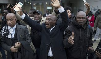 FILE - In this Jan. 16, 2019, file photo, supporters of former Ivory Coast President Laurent Gbagbo celebrate outside the International Criminal Court in The Hague, Netherlands, after judges ruled that Gbagbo and a former government minister should be released immediately following their acquittal on charges of involvement in deadly post-election violence in 2010. The acquittal at the International Criminal Court is causing some to celebrate his pending release but others fear a repeat of the deadly 2010-2011 post-election violence that led him to The Hague. (AP Photo/Peter Dejong, File)