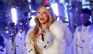 In this Dec. 31, 2017, file photo, Mariah Carey performs at the New Year's Eve celebration in Times Square in New York. Carey, one of the world's most celebrated artists, is performing in Saudi Arabia for the first time, but there's a growing chorus of Saudi women calling on her to cancel the concert in support of detained women's rights activists. (Photo by Brent N. Clarke/Invision/AP, File)