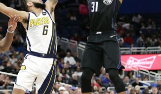 Orlando Magic's Terrence Ross (31) shoots over Indiana Pacers' Cory Joseph (6) during the second half of an NBA basketball game, Thursday, Jan. 31, 2019, in Orlando, Fla. (AP Photo/John Raoux)