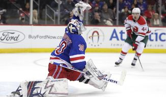 New York Rangers goaltender Henrik Lundqvist (30), of Sweden, makes a save against the New Jersey Devils during the second period of an NHL hockey game, Thursday, Jan. 31, 2019, in Newark, N.J. (AP Photo/Julio Cortez)