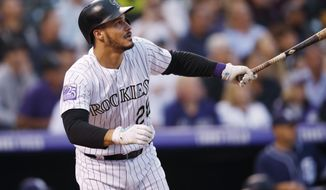 FILE - In this Aug. 21, 2018, file photo, Colorado Rockies' Nolan Arenado watches his RBI-double off San Diego Padres pitcher Robbie Erlin during a baseball game in Denver. Arenado and the Rockies have agreed to a $26 million, one-year deal to avoid arbitration, the largest ever one-year salary for an arbitration-eligible player. Colorado announced the deal Thursday, Jan. 31. (AP Photo/David Zalubowski, File)