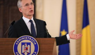 "NATO Secretary-General Jens Stoltenberg gestures during a media statement in Bucharest, Romania, Thursday, Jan. 31, 2019. NATO's chief has called on China to treat detained two Canadian citizens ""fairly and with due process."" (AP Photo/Vadim Ghirda)"