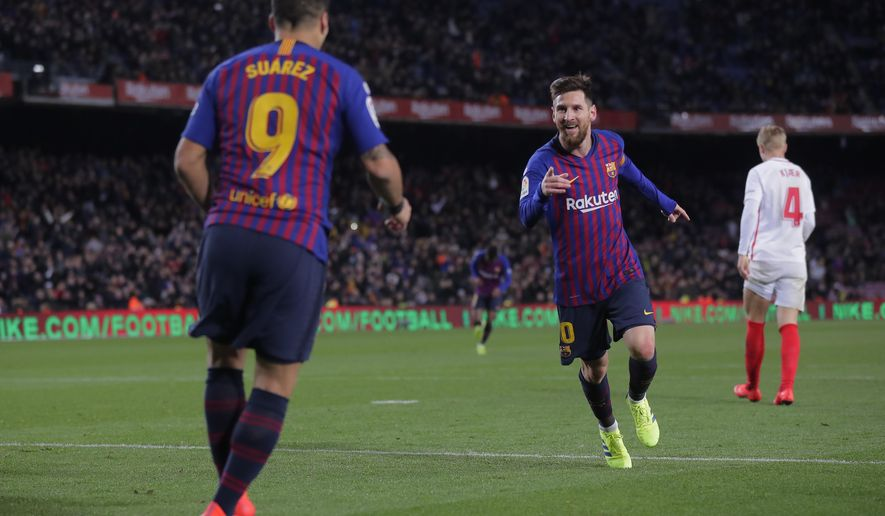 FC Barcelona's Lionel Messi celebrates after scoring during a Spanish Copa del Rey soccer match between FC Barcelona and Sevilla at the Camp Nou stadium in Barcelona, Spain, Wednesday, Jan. 30, 2019. (AP Photo/Manu Fernandez)