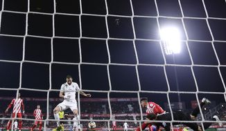Real Madrid's Benzema, center left, in action during a Spanish Copa del Rey soccer match between Girona and Real Madrid at the Montilivi stadium in Girona, Spain, Thursday, Jan. 31, 2019. (AP Photo/Manu Fernandez)