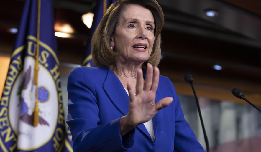 Speaker of the House Nancy Pelosi, D-Calif., talks to reporters during a news conference a day after a bipartisan group of House and Senate bargainers met to craft a border security compromise aimed at avoiding another government shutdown, at the Capitol in Washington, Thursday, Jan. 31, 2019. (AP Photo/J. Scott Applewhite)