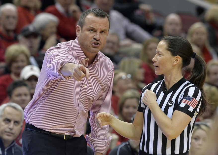 Louisville coach Jeff Walz argues a call with game official Maj Forsberg during the first half of an NCAA college basketball game against Connecticut in Louisville, Ky., Thursday, Jan. 31, 2019. (AP Photo/Timothy D. Easley)