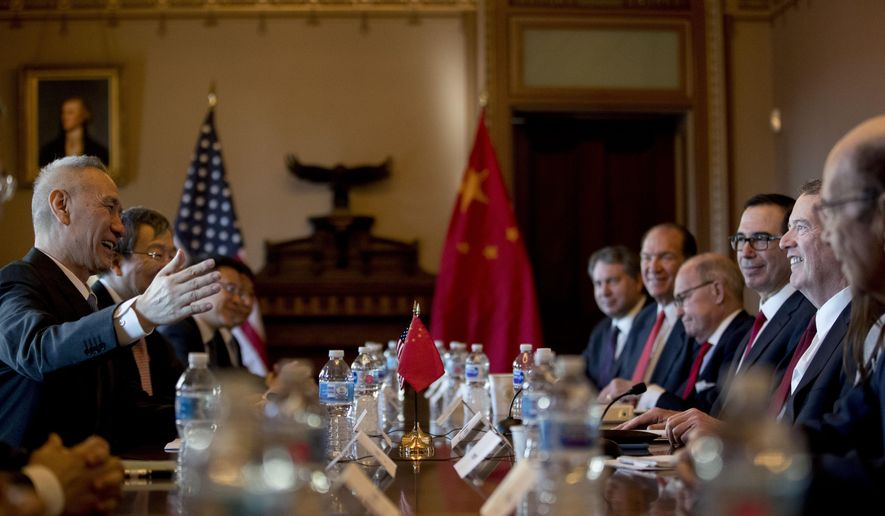 US Trade Representative Robert Lighthizer, right, accompanied by Trump Administration officials, meets with Chinese Vice Premier Liu He, left, and other Chinese officials as they begin US-China Trade Talks in the Diplomatic Room of the Eisenhower Executive Office Building on the White House Complex, Wednesday, Jan. 30, 2019, in Washington. (AP Photo/Andrew Harnik)