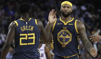 Golden State Warriors' DeMarcus Cousins, right, celebrates a score with Draymond Green (23) during the first half of an NBA basketball game against the Philadelphia 76ers on Thursday, Jan. 31, 2019, in Oakland, Calif. (AP Photo/Ben Margot)