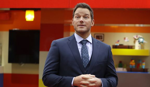 """Actor Chris Pratt poses for the media to open the Lego pop-up cafe """"The Coffee Chain"""" in, London, Friday, Feb. 1, 2019. The pop-up cafe promotes the new """"The Lego Movie 2"""" film and is in partnership with UNICEF to raise awareness and proceeds. (AP Photo/Kirsty Wigglesworth)"""