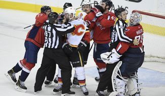 Members of the Washington Capitals and the Calgary Flames scuffle after an NHL hockey game Friday, Feb. 1, 2019, in Washington. (AP Photo/Nick Wass) ** FILE **