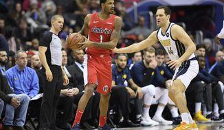 Washington Wizards forward Trevor Ariza (1) handles the ball against Indiana Pacers forward Bojan Bogdanovic (44) during the second half of an NBA basketball game, Wednesday, Jan. 30, 2019, in Washington. The Wizards won 107-89. (AP Photo/Nick Wass)