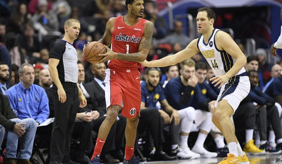 Washington Wizards forward Trevor Ariza (1) handles the ball against Indiana Pacers forward Bojan Bogdanovic (44) during the second half of an NBA basketball game, Wednesday, Jan. 30, 2019, in Washington. The Wizards won 107-89. (AP Photo/Nick Wass)