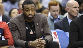 Washington Wizards guard John Wall sits on the bench during the first half of an NBA basketball game against the Indiana Pacers, Wednesday, Jan. 30, 2019, in Washington. (AP Photo/Nick Wass)