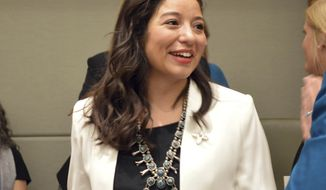"""FILE - In this Jan. 15, 2019 file photo, New Mexico state Rep. Andrea Romero, D-Santa Fe, talks to fellow lawmakers before the start of the New Mexico Legislative session in Santa Fe, N.M. Romero said Friday, Feb. 1, 2019, she was withdrawing a measure she sponsored that would have forced media to delete """"irrelevant"""" material from their archives after she received strong criticism. (AP Photo/Russell Contreras, File)"""
