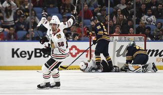 Chicago Blackhawks defenseman Erik Gustafsson (56) celebrates a Chicago goal during the second period of the team's NHL hockey game against the Buffalo Sabres in Buffalo, N.Y., Friday, Feb. 1, 2019. (AP Photo/Adrian Kraus)