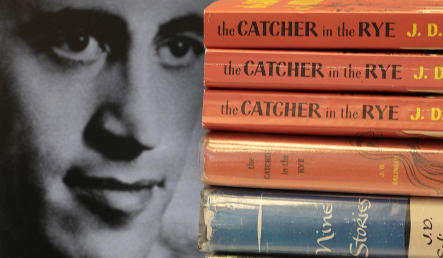 """FILE - This Thursday, Jan. 28, 2010, file photo shows copies of J.D. Salinger's classic novel """"The Catcher in the Rye"""" as well as his volume of short stories called """"Nine Stories"""" at the Orange Public Library in Orange Village, Ohio. In comments which appeared Friday, Feb. 1, 2019 in The Guardian, Matt Salinger, son of the famous author, confirmed longstanding reports that his father had continued to write long after he stopped publishing books and that he and Salinger's widow are """"going as fast as we freaking can"""" to prepare the material for release. (AP Photo/Amy Sancetta, File)"""