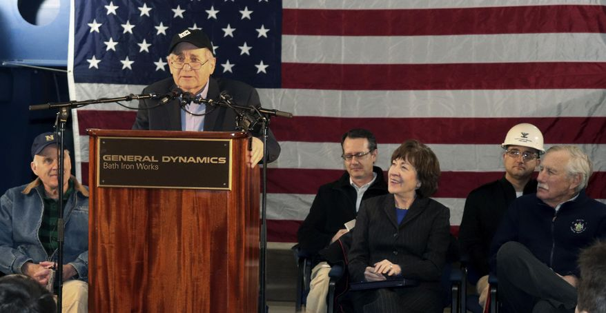Former Sen. Carl Levin, of Michigan, addresses a gathering at Bath Iron Works, where a warship that bears his name is under construction, Friday, Feb. 1, 2019, in Bath, Maine. In the front row from left are U.S. Navy Secretary Richard Spencer, Levin, U.S. Sen. Susan Collins (R-Me.) and U.S. Sen. Angus King (I-Me.). (AP Photo/David Sharp)