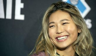 FILE - In this Wednesday, Jan. 23, 2019, file photo, snowboarder Chloe Kim smiles at an X Games press conference in Aspen, Colo. Heading to Princeton next fall, Kim is trading her board for books as she tries to blend in and become your normal college freshman.  (Anna Stonehouse/The Aspen Times via AP, File)