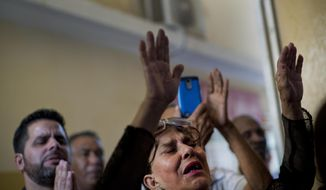 Evangelicals pray during a Mass at a church in Havana, Cuba, Sunday, Jan. 27, 2019. A Cuban government push to legalize gay marriage has set off an unprecedented reaction from the island's rapidly growing evangelical churches, whose members are expected to widely reject a state-proposed constitutional reform in a nationwide referendum this month.(AP Photo/Ramon Espinosa)