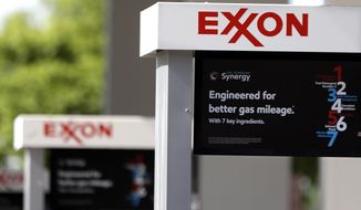 FILE- This April 25, 2017, file photo, shows Exxon service station signs in Nashville, Tenn. Exxon Mobil Corp. reports earnings Friday, Feb. 1, 2019. (AP Photo/Mark Humphrey, File)