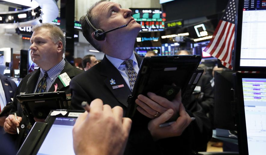 FILE- In this Dec. 28, 2018, file photo trader Jonathan Corpina, right works on the floor of the New York Stock Exchange. The U.S. stock market opens at 9:30 a.m. EST on Friday, Feb. 1. (AP Photo/Richard Drew, File)