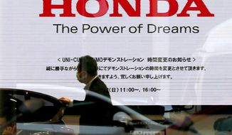 FILE - In this  Jan. 11, 2016, file photo, the logo of Honda Motor Co. is seen on a showroom screen at the Japanese automaker's headquarters in Tokyo. The Japanese automaker reported a 71 percent decline in fiscal third-quarter profit as air-bag recalls and flat vehicle sales eroded the benefits of cost cuts. (AP Photo/Shuji Kajiyama, File)