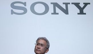 FILE - In this May 22, 2018, file photo, Sony Corp. President Kenichiro Yoshida attends at a press conference at the company's headquarters in Tokyo. Japanese electronics and entertainment company Sony on Friday, Feb. 1, 2019, reported a 45 percent surge in fiscal third-quarter profit on tax reductions, a favorable exchange rate and gains in its music segment. (AP Photo/Eugene Hoshiko, File)