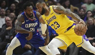 Los Angeles Lakers forward LeBron James, right, tries to drive past Los Angeles Clippers guard Patrick Beverley during the first half of an NBA basketball game Thursday, Jan. 31, 2019, in Los Angeles. (AP Photo/Mark J. Terrill)