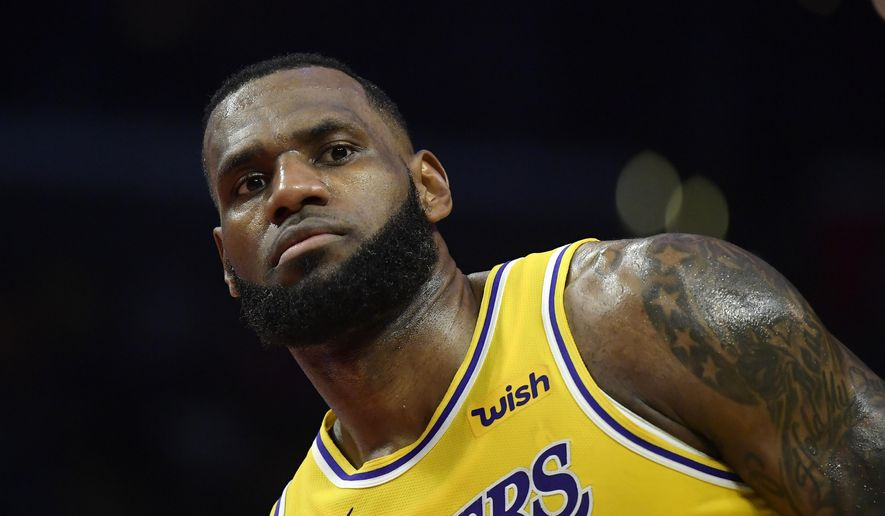 Los Angeles Lakers forward LeBron James stands on the court during the second half of an NBA basketball game against the Los Angeles Clippers Thursday, Jan. 31, 2019, in Los Angeles. The Lakers won 123-120. (AP Photo/Mark J. Terrill)