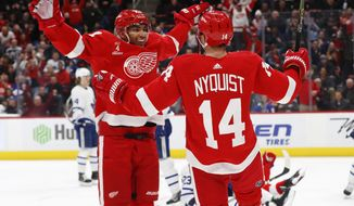 Detroit Red Wings right wing Gustav Nyquist (14) celebrates his goal with Andreas Athanasiou in the second period of an NHL hockey game against the Toronto Maple Leafs, Friday, Feb. 1, 2019, in Detroit. (AP Photo/Paul Sancya)