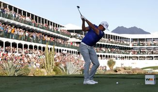 Rickie Fowler hits from the 16th tee during the second round of the Phoenix Open PGA golf tournament, Friday, Feb. 1, 2019, in Scottsdale, Ariz. (AP Photo/Matt York)
