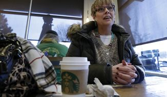 In this Tuesday, Jan. 29, 2019, photo Laurie Ware, a customer at Starbucks in Nashua, N.H., speaks about a potential presidential run by Starbucks founder Howard Schultz. Some people are already calling for a boycott of Starbucks, and the company itself emphasized that all customers, regardless of political affiliation, are welcome at its stores. (AP Photo/Elise Amendola)