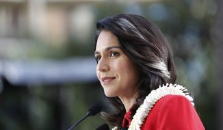 U.S. Rep. Tulsi Gabbard, D-Hawaii, speaks during a campaign rally announcing her candidacy for president in Waikiki, Saturday, Feb. 2, 2019, in Honolulu. (AP Photo/Marco Garcia)
