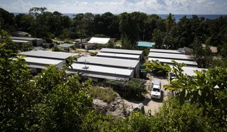 FILE - This Sept. 4, 2018, file photo shows Nibok refugee settlement on Nauru. Australia announced on Sunday, Feb. 3, 2019 that the last child refugees held on the Pacific atoll of Nauru will soon the sent to the United States, ending the banishment of children under the government's harsh asylum-seeker policy as elections loom. (Jason Oxenham/Pool Photo via AP, File)