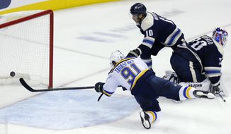St. Louis Blues forward Vladimir Tarasenko, left, of Russia, scores past Columbus Blue Jackets forward Alexander Wennberg, center, of Sweden, and goalie Joonas Korpisalo, of Finland, during the third period of an NHL hockey game in Columbus, Ohio, Saturday, Feb. 2, 2019. The Blues won 4-2. (AP Photo/Paul Vernon)