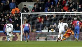 Crystal Palace's Luka Milivojevic, left,  scores his side's first goal of the game, during the English Premier League soccer match between Crystal Palace and Fulham at Selhurst Park, in London, Saturday Feb. 2, 2019. (Jonathan Brady/PA via AP)