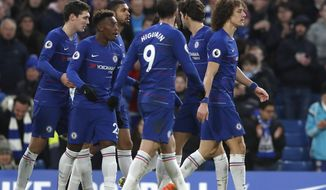 Chelsea's David Luiz, right, celebrates with teammates after scoring his side's fifth goal during the English Premier League soccer match between Chelsea and Huddersfield Town at Stamford Bridge stadium in London, Britain, Saturday, Feb. 2, 2019. (AP Photo/ Alastair Grant)