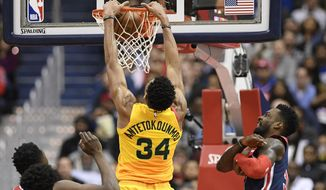 Milwaukee Bucks forward Giannis Antetokounmpo (34) dunks against Washington Wizards forward Jeff Green, right, during the first half of an NBA basketball game, Saturday, Feb. 2, 2019, in Washington. Green was called for a foul on the play. (AP Photo/Nick Wass) ** FILE **