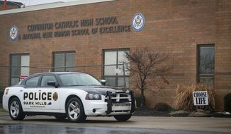"In this Saturday, Jan 19, 2019, file photo, a police car sits in front of Covington Catholic High School in Park Hills, Ky. The news about Karen Pence's teaching job at a Christian school in northern Virginia that lists ""homosexual or lesbian sexual activity"" as among the disqualifying criteria for prospective employees, was quickly followed by debate over the behavior of boys from this school during a January 2019 visit to Washington. While opinions varied widely as to whether the boys had behaved badly, that incident further fueled debate over faith-based schools and the world view of their students. (AP Photo/Bryan Woolston) ** FILE **"
