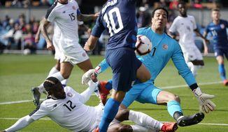 Costa Rica goalkeeper Esteban Alvarado (1) blocks a shot by United States midfielder Christian Roldan (10) during the first half of an international friendly soccer match on Saturday, Feb. 2, 2019, in San Jose, Calif. (AP Photo/Tony Avelar)
