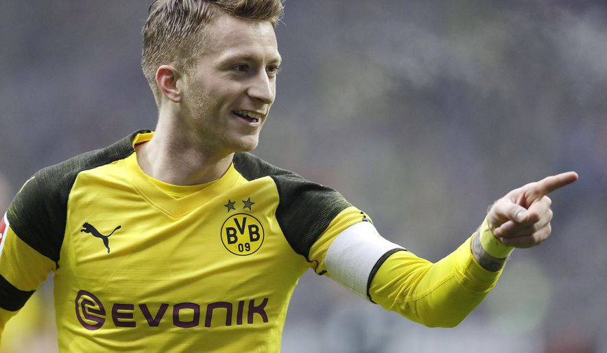 Dortmund's Marco Reus celebrates the opening goal during a German Bundesliga soccer match between Eintracht Frankfurt and Borussia Dortmund in Frankfurt, Germany, Saturday, Feb. 2, 2019. (AP Photo/Michael Probst)
