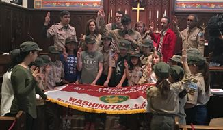 Members of Scout BSA Troop 248, one of the first girls to join the Boy Scouts of America, say the organization's pledge at their welcoming ceremony on Saturday, Feb. 2, 2019, in Washington, D.C. (Laura Kelly/The Washington Times)