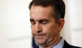 Virginia Gov. Ralph Northam pauses during a news conference in the Governor's Mansion in Richmond, Va., on Saturday, Feb. 2, 2019. Northam is under fire for a racial photo that appeared in his college yearbook. (AP Photo/Steve Helber)