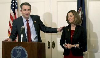 Virginia Gov. Ralph Northam, left, with his wife Pam at his side, speaks during a press conference in the Executive Mansion on Saturday, Feb. 2, 2019.  Northam is under fire for a racial photo that appeared in his college yearbook.  (Steve Earley/The Virginian-Pilot via AP)